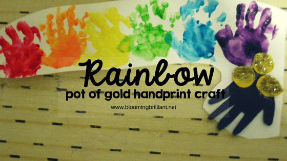 Rainbow Pot of Gold Handprint Craft is the perfect craft for babies and toddlers to help celebrate St. Patrick's Day. #Craftsforkids